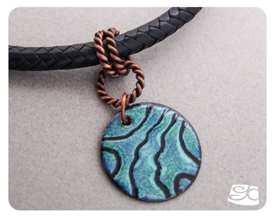 Picture of Handmade Artisan Torch fired enamel pendant in black, blues and greens.