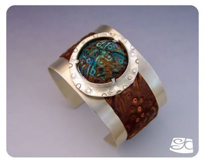 Picture of Handmade sterling silver cuff with foldformed tab-set copper cabochon.